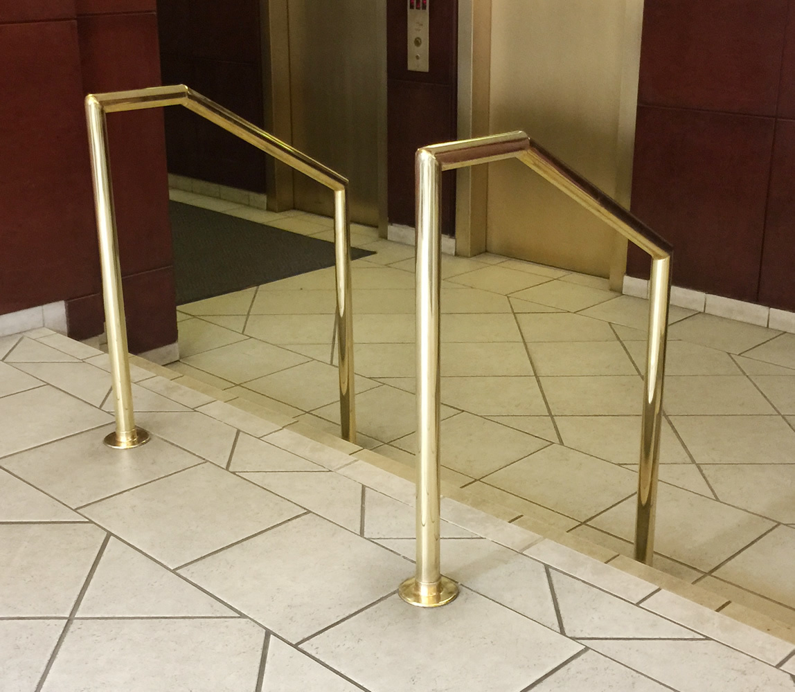 Polished brass stair rail