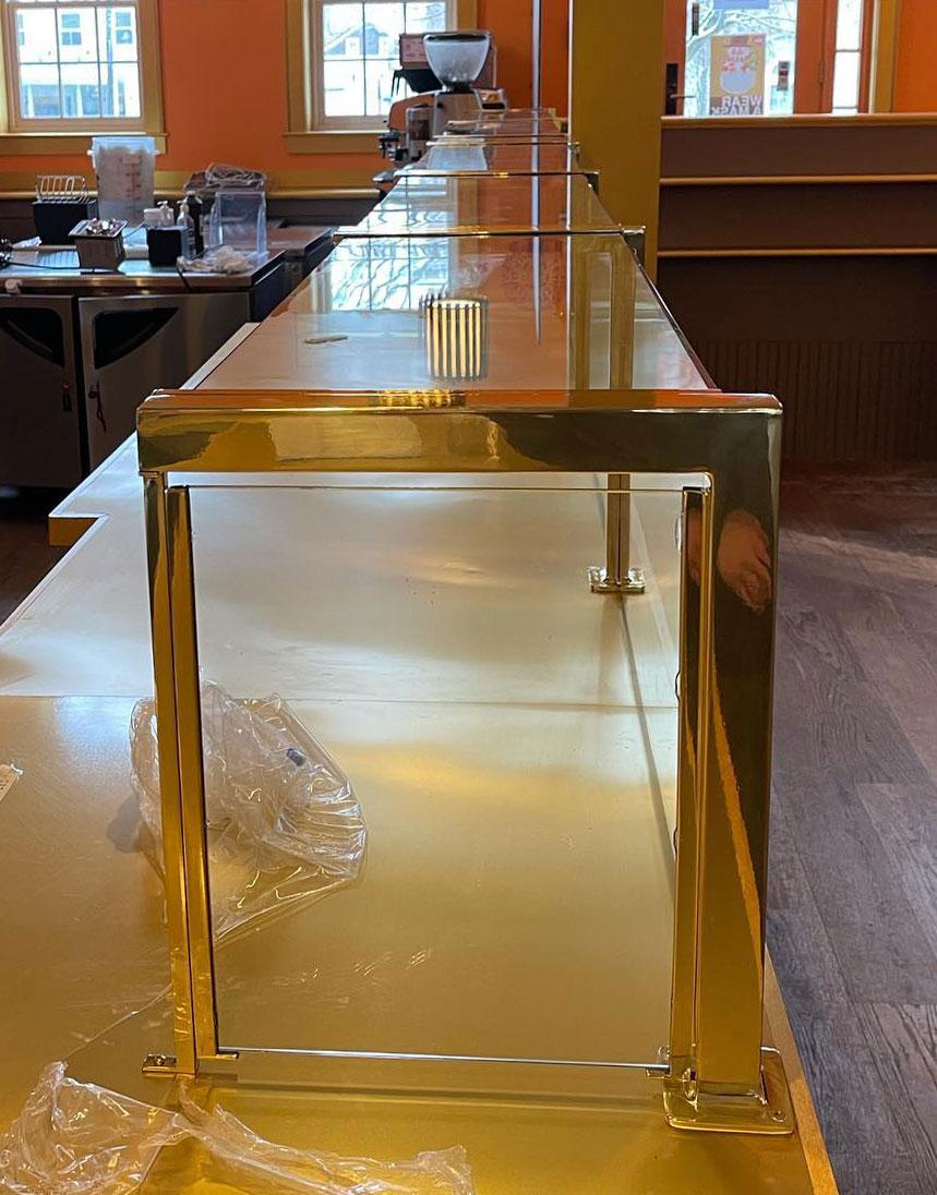Custom Polished Lacquered Brass Food Shield - The Buddha Berry, Sag Harbor, NY
