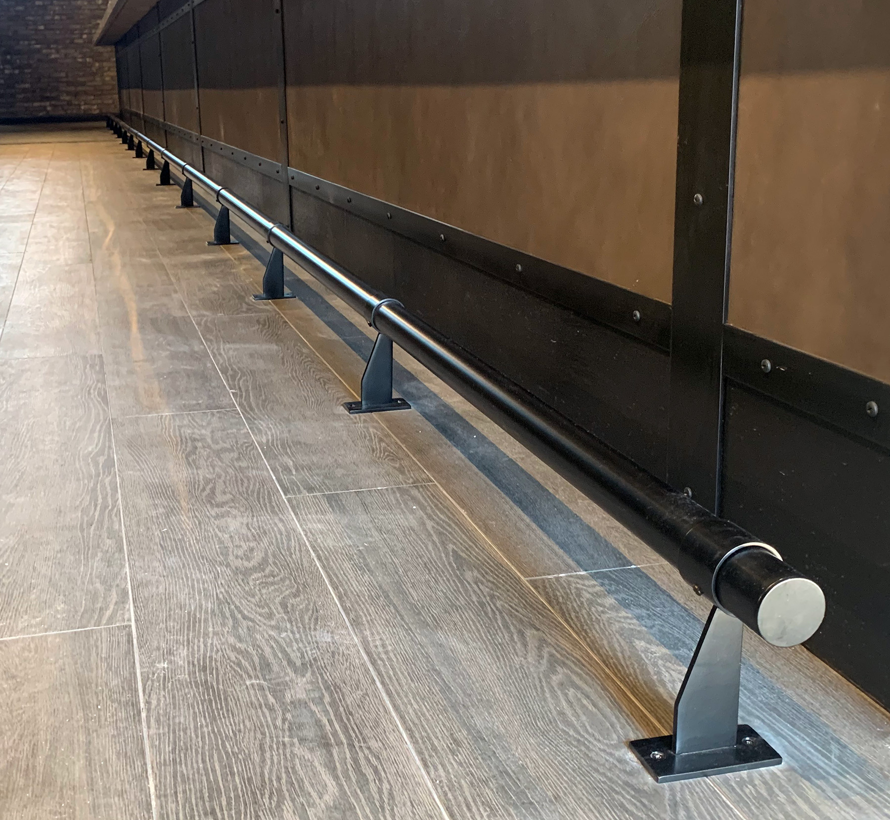 Black Powder Coated Bar Foor Rail - Mukcahy's Pub, Wantagh, NY