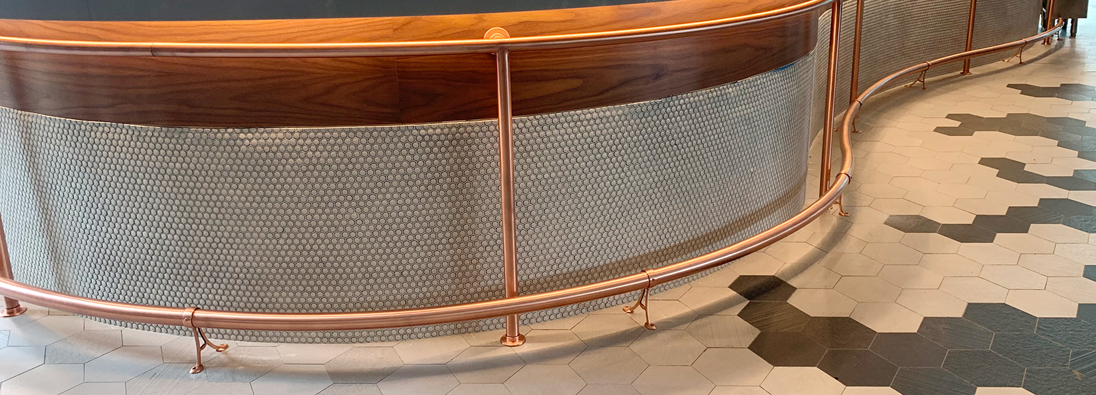 Satin Copper Curved Foot Rail | One 10, Huntington, NY