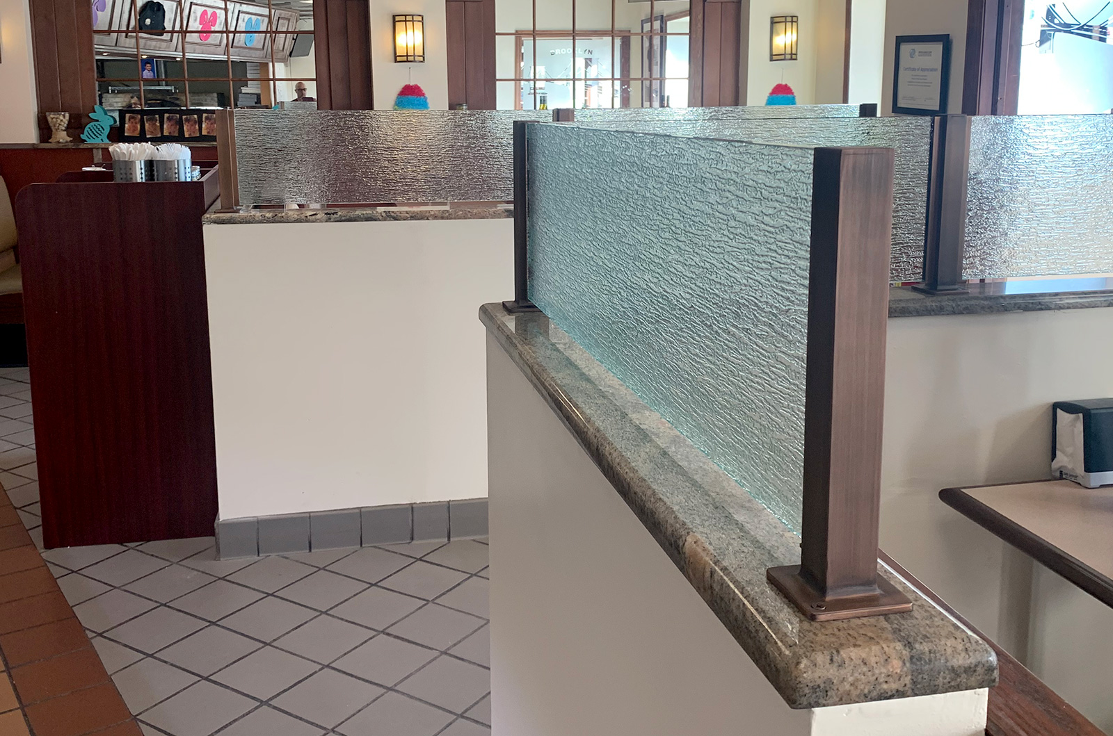 Antique Bronze Partition Posts with Waved Glass | Pietro's Brick Oven Pizzeria - Oyster Bay, NY